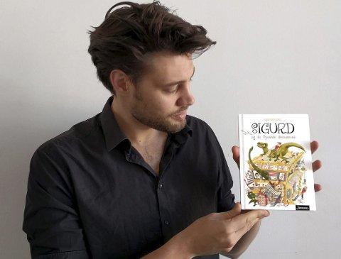 Debutant: Å illustrere «Sigurd og de flyvende dinosaurene» har vært en utfordrende oppgave for Johan Reisang, men oppdraget har også gitt mersmak. – Hovedutfordringen ligger i å vekke til live igjen den magien man ser verden med som barn, synes han. Foto: Privat