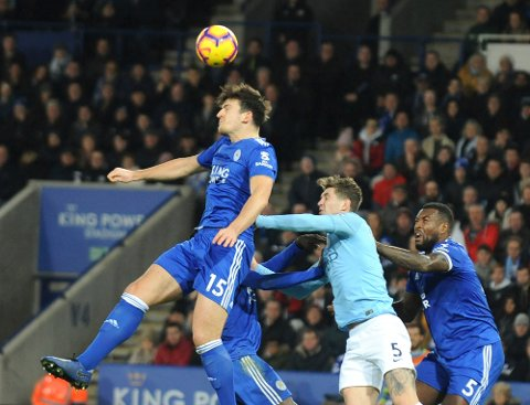 Leicester's Harry Maguire controls the ball in the air ahead of Manchester City's John Stones during the English Premier League soccer match between Leicester City and Manchester City at the King Power Stadium in Leicester, England, Wednesday, Dec. 26, 2018. (AP Photo/Rui Vieira)