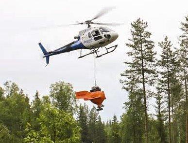Gjødsling: Helikopterfirmaet Pegasus kommer til Mørk i Spydeberg mandag og demonstrerer gjødsling av skog. FOTO: Privat