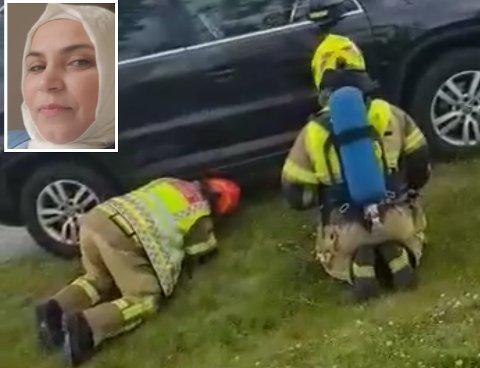 STORE SKADER: Bilen til Ilham Khamis fikk store skader i understellet da hun kjørte over metallgjenstanden som lå i veibanen. Brannvesenet la ut flis på området for å tørke opp i dieselsølet. Bildet viser brannbetjenter som undersøker skadene på bilen.