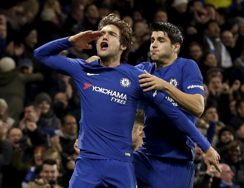 Chelsea's Marcos Alonso, left, celebrates after scoring a goal with teammate Alvaro Morata during the English Premier League soccer match between Chelsea and Brighton & Hove Albion at Stamford Bridge in London, Tuesday Dec. 26, 2017. (AP Photo/Tim Ireland)