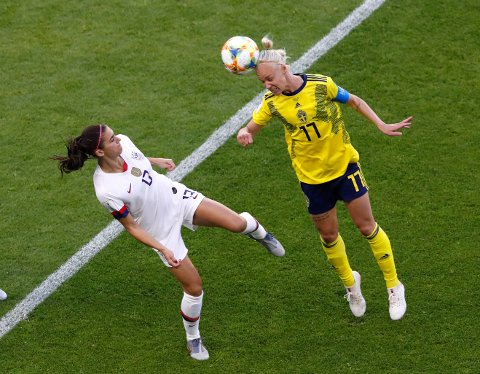 United States' Alex Morgan, left, and Sweden's Caroline Seger challenge for the ball during the Women's World Cup Group F soccer match between the United States and Sweden at the Stade Oceane in Le Havre, France, Thursday, June 20, 2019. (AP Photo/Christophe Ena)