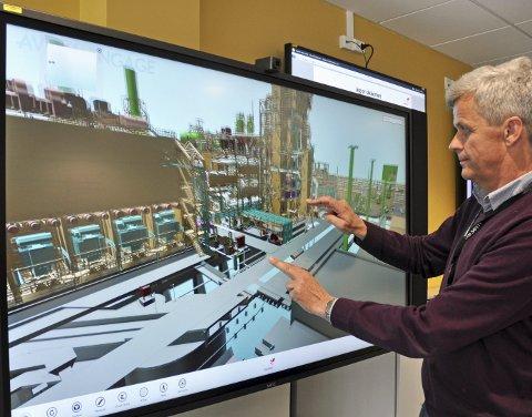 TREDIMENSJONALT: Hammerfest LNG på 3D- storskjerm vil bli et nyttig verktøy i planlegging. Her demonstrerer Tore Omtveit.ALLE FOTO: Svein G. Jørstad
