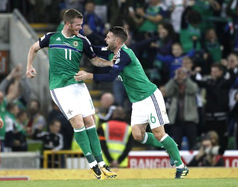 Northern Ireland's Chris Brunt, left, celebrates with Oliver Norwood after scoring a goal against Czech Republic's during the World Cup Group C qualifying soccer match between Northern Ireland and Czech Republic at Windsor Park, Belfast, Northern Ireland, Monday, Sept. 4, 2017. (AP Photo/Peter Morrison)
