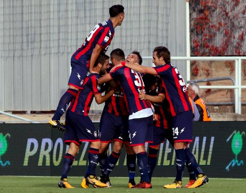 Crotone's Marcello Trotta, center, celebrates with his teammates after scoring during the Serie A soccer match between Crotone and Fiorentina,  at the Ezio Scida stadium in Crotone, Italy, Sunday, Oct. 29, 2017. (Albano Angilletta/ANSA via AP)
