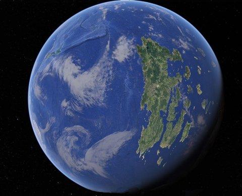 En blå planet med en grønn øy hvor det er forutsetninger for et bærekraftig liv.