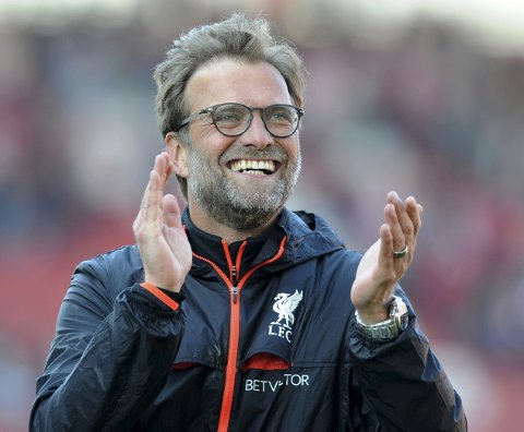Liverpool manager Juergen Klopp applauds fans after Liverpool beat Stoke 2-1 during the English Premier League soccer match between Stoke City and Chelsea at the Britannia Stadium, Stoke on Trent, England, Saturday, April 8, 2017. (AP Photo/Rui Vieira)