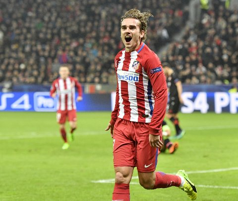 Atletico's Antoine Griezmann celebrates after scoring his side's second goal during the Champions League round of 16 first leg soccer match between Bayer Leverkusen and Atletico Madrid in Leverkusen, Germany, Tuesday, Feb. 21, 2017. (AP Photo/Martin Meissner)