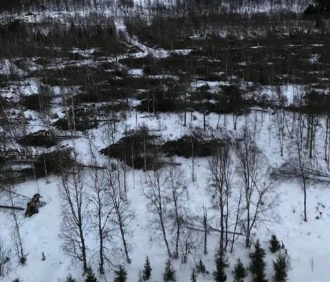 """STORE ØDELEGGELSER:"""" Ylva"""" førte til store ødeleggelser i Troms. Her er et bilde fra Salangsdalen fra Troms Kraft Netts helikopterbefaringer i 2017."""