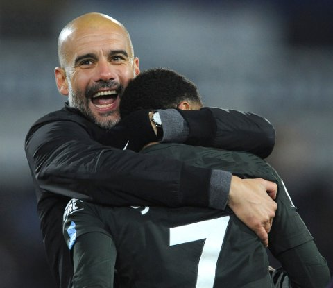 Manchester City manager Josep Guardiola, left, celebrates with goal scorer Manchester City's Raheem Sterling after the final whistle during the English Premier League soccer match between Huddersfield Town and Manchester City at John Smith's stadium, in Huddersfield, England, Sunday, Nov. 26, 2017. (AP Photo/Rui Vieira)