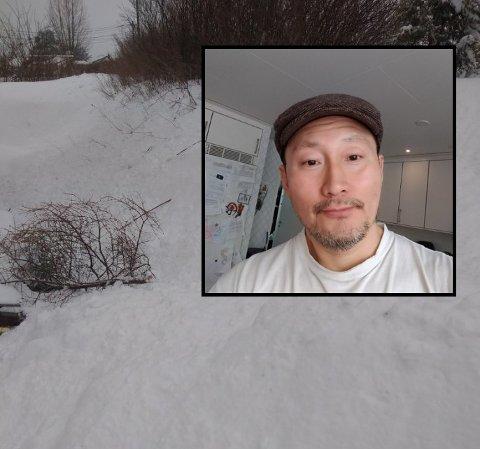 BRØYTEKANT: Huck Chi ble nødt til å finne frem snøskuffen og grave frem innkjørselen etter at det ble brøytet utenfor huset.