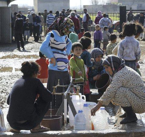Syriske flyktninger: Fredrikstad vil ta imot 68 ekstra syriske flyktninger fordelt på 2015 og 2016, dersom Norge vedtar å ta imot de 10.000 flyktningene som er foreslått. Foto: REUTERS/Umit Bektas