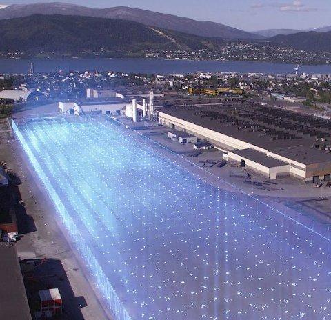 LYSENDE FREMTID? Mange har forestilt seg hvordan fremtidens batterifabrikker kan komme til å se ut. Både NHO og Nordland fylkeskommune håper det uansett er snakk om en lysende fremtid.