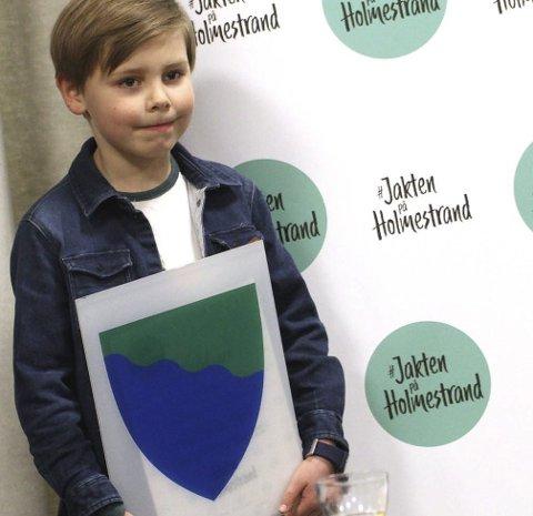 Yngst:   Liam Aleksander Starheim Akselsen (8) med sitt bidrag Sjø og land.foto: jarl Rehn-Erichsen