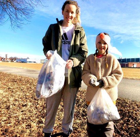 Ni år gamle Thea Madelen Strand tok med seg størsøster Susann Renate Moen (30) på en flere timer lang ryddeaksjon langs Oscar Pedersensvei søndag.