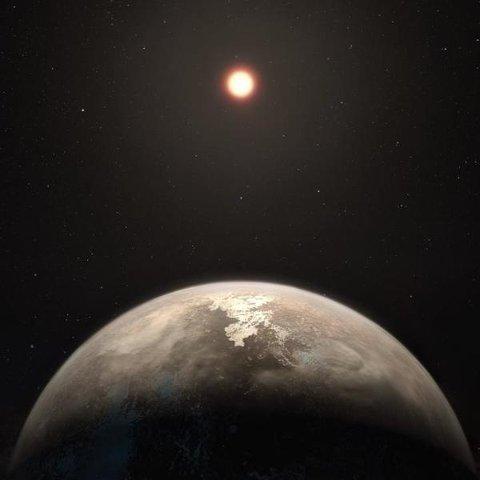 ROSS 128 B: Slik ser forskerne for seg at planeten Ross 128 B kan se ut, der den går i bane rundt den røde dvergstjernen Ross 128.