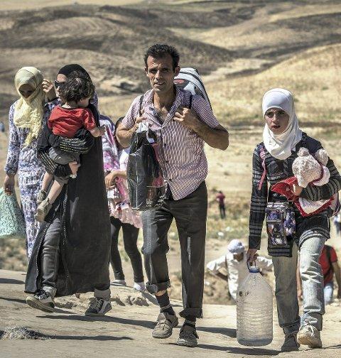 FLUKTEN: 12 av Syrias 20 mill. innbyggere er på flukt. 4,5 mill.har flyktet ut av Syria. 2313 søkte asyl i Norge i august. De fleste syrere. Foto: Christian Jepsen, flyktninghjelpen (ANB)
