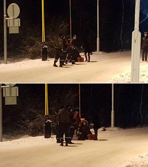 STOPP: Her er norsk politi sammen med asylsøkere på grensen mellom Russland og Norge fredag ettermiddag. Ifølge PU er det totalt fem personer forsøkt sendt tilbake til Russland i henhold til Justis- og beredskapsdepartementets nye instruks. Det har foreløpig ikke lyktes.