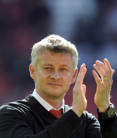 Manchester United manager Ole Gunnar Solskjaer applauds to supporters at the end of the English Premier League soccer match between Manchester United and Cardiff City at Old Trafford in Manchester, England, Sunday, May 12, 2019. (AP Photo/Rui Vieira)
