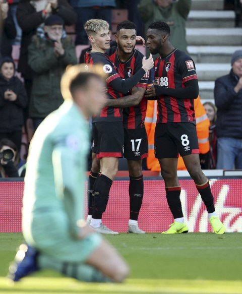 Bournemouth's Joshua King, center, celebrates with teammates after scoring his side's first goal during a Premier League soccer match between Bournemouth and Arsenal, at The Vitality Stadium, Bournemouth, Sunday, Nov. 25, 2018. (John Walton/PA via AP)