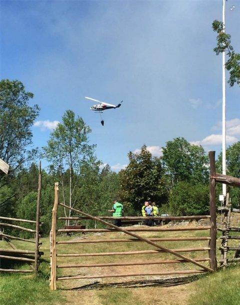 Helikopteret er på plass...pluss brannvesenet fra Eidsberg og Marker.