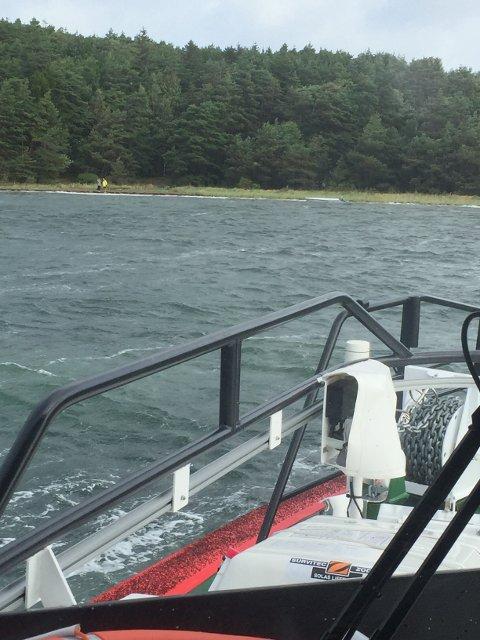 Her letes det etter personene som satt i båten.