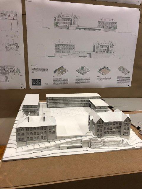 En ny ungdomsskole hører til i sentrum, mener noen av studentene, og har fått plass til et stort nybygg bak de to gamle skolebyggene på Breidablik.