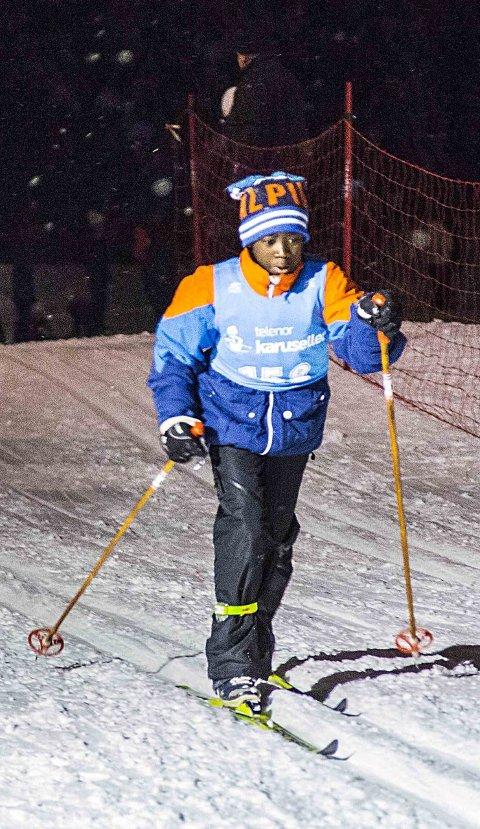 Første skirenn: San Nuru Sonko (10) fra Lande barneskole deltok i skolekarusellrennet i Trøsken for første gang tirsdag kveld. - Dette var veldig moro, sa Sonko. alle bilder: Vetle Granath Magelssen