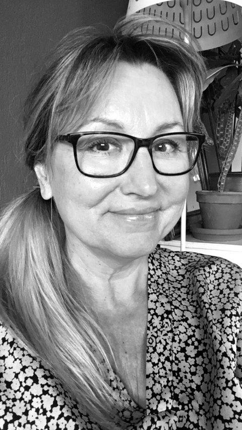 Marianne K Finstad