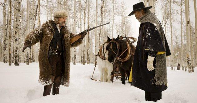NÅDELØSE: Kurt Russell og Samuel L. Jackson har to av hovedrollene i Tarantinos nye film; The Hateful Eight.Photo: Andrew Cooper, SMPSP