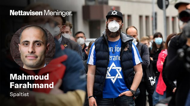 14. MAI: Hundrevis av mennesker holder vakt utenfor en synagoge i Tyskland etter antisemittiske protester.