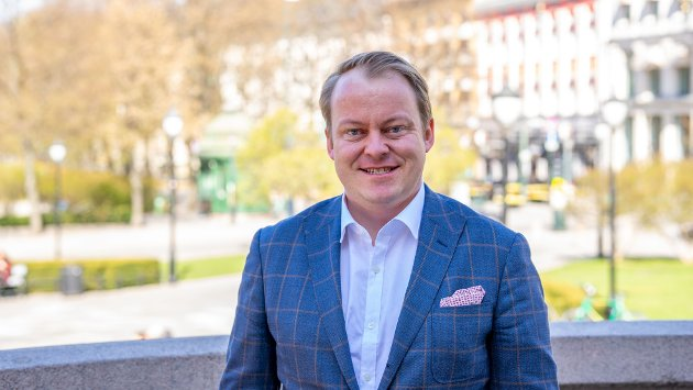 Fornøyd med oppgjøret: Erlend Wiborg utenfor Stortinget.