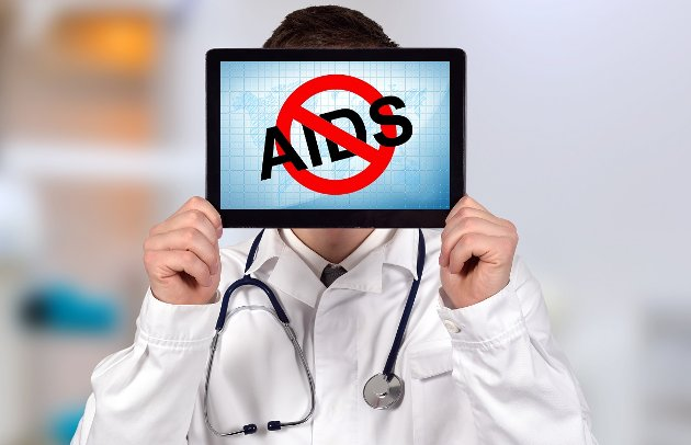 doctor holding touch pad with stop aids on a clinic background