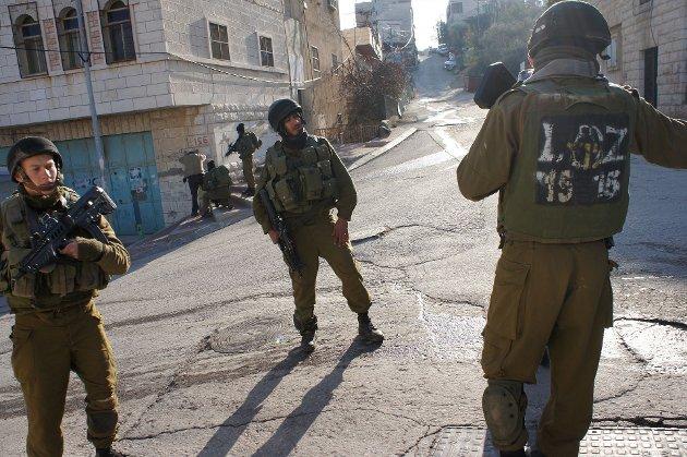 Israelske soldater på gata i Hebron på Vestbredden