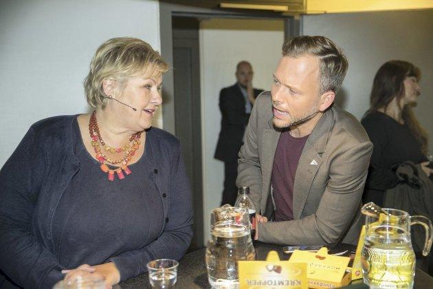 Statsminister Erna Solberg (H) og Audun Lysbakken (Sv) er uenige om barnetrygden. Høyre vil ikke øke selv om beløpet har stått stille i 22 år. SV krever økning for å bekjempe barnefattigdom og får nå støtte også fra FN-hold.