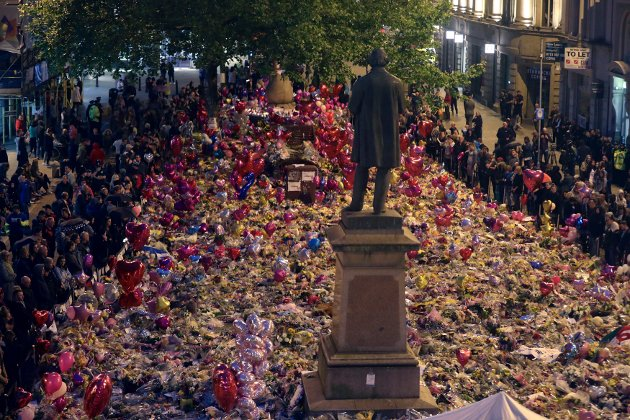 People view tributes to victims in St Ann's Square as they prepare to mark the passing of exactly a week since the Manchester Arena concert blast, in Manchester, England, Monday May 29, 2017. (Owen Humphreys/PA via AP)