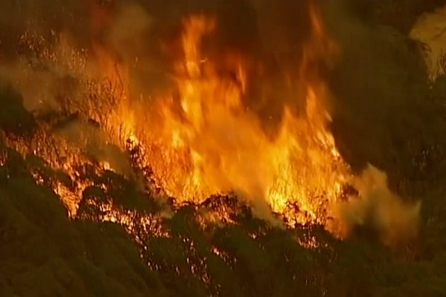 In this image made from video, an aerial scene shows fires burning in East Grippsland, Victoria state, Tuesday, Dec. 31, 2019. Wildfires burning across Australia's two most-populous states Tuesday trapped residents of a seaside town in apocalyptic conditions, destroyed many properties. (Australian Broadcasting Corporation, Channel 7, Channel 9 via AP)
