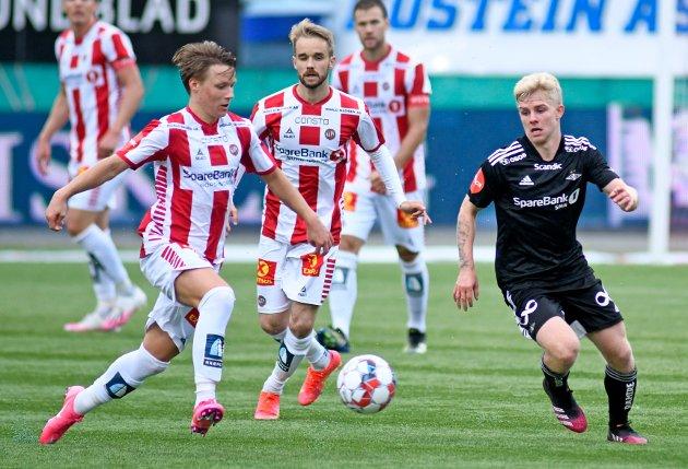 TILs August Mikkelsen og Daniel Berntsen og Rosenborgs Edvard Tagseth i eliteseriekampen på Alfheim 18. juli - som TIL tapte 1-3.