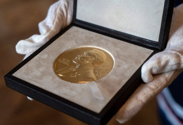 FILE - A Tuesday, Dec. 8, 2020 file photo of a Nobel Prize medal. The Nobel Peace Prize will be awarded on Friday Oct. 8, 2021.(AP Photo/Jacquelyn Martin, File)