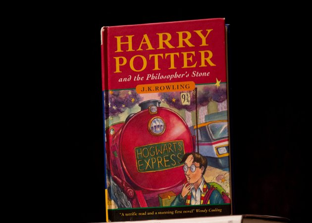 "FILE - This May 20, 2013, file photo shows a first edition copy of the first Harry Potter book ""Harry Potter and the Philosopher's Stone"" during a photocall organized for the media at the Sotheby's auction house's premises in London. A Catholic school in Tennessee has removed the Harry Potter books from its library after the school's priest decided they could cause a reader to conjure evil spirits. (AP Photo/Matt Dunham, File)"