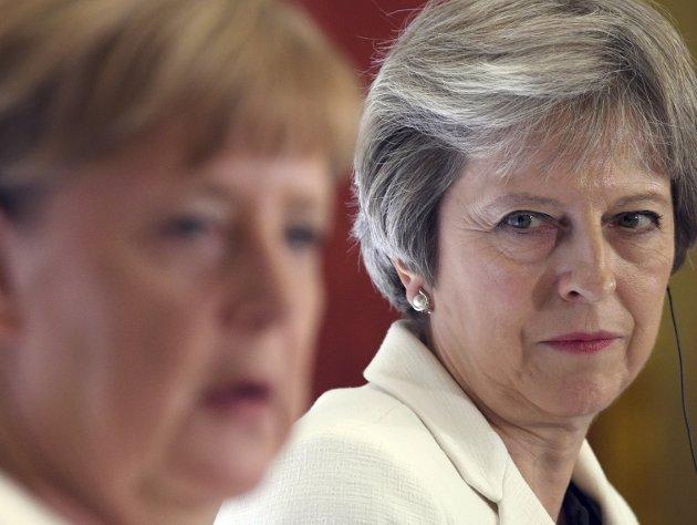 Angela Merkel og Theresa May. Begge har fått svekket sin makt og autoritet som et resultat av interne konflikter i sin regjering. Stefan Rousseau