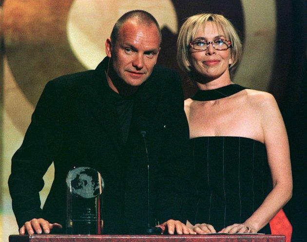 NYK08:GQ-AWARDS:NEW YORK,21OCT98 - Rock star Sting and his wife Turdie Styler accept the Zegna Environmental award for their work with the Rainforest Foundation at the GQ Men of the Year awards show, October 21 in New York. Sting was also given the Solo Artist award during the show.      jc/Photo by Jeff Christensen REUTERS