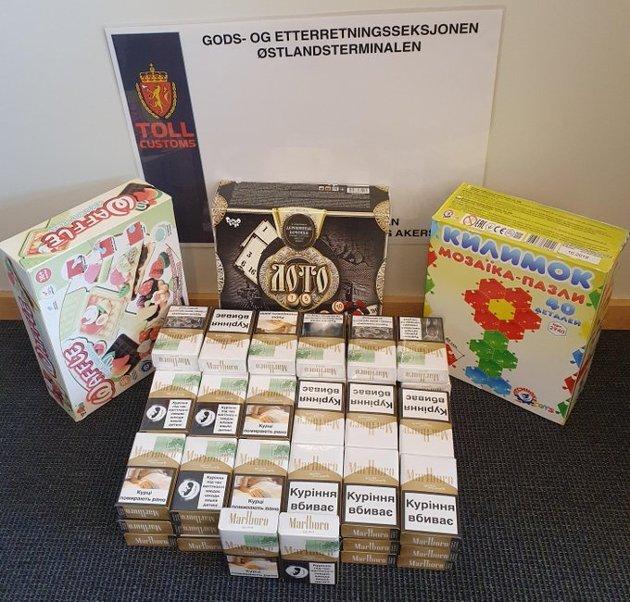 SIGARETTER I SPILL: Tirsdag ble det beslaglagt en sending med 1240 sigaretter, troverdig kamuflert som brettspill/familiespill.