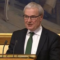 Steinar Ness på talarstolen i Stortinget