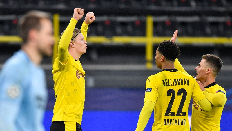 Dortmund's Erling Braut Haaland, left, celebrates with teammates his second goal during the Champions League group F soccer match between Borussia Dortmund and Club Brugge in Dortmund, Germany, Tuesday, Nov. 24, 2020. (AP Photo/Martin Meissner)