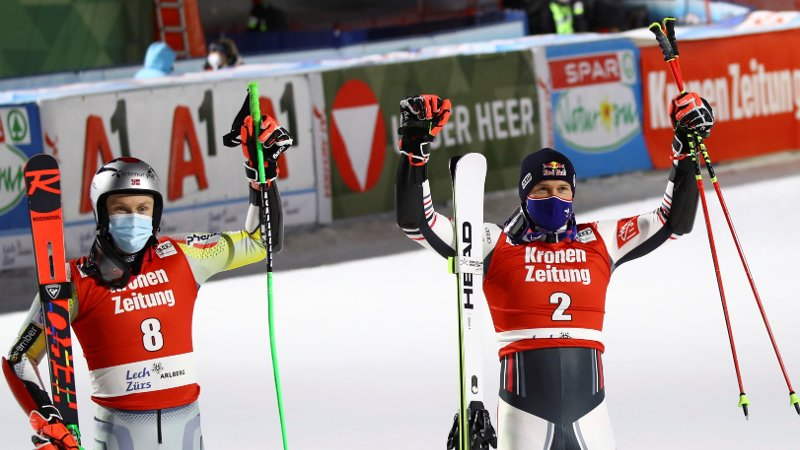 From left, Norway's Henrik Kristoffersen, second placed, France's Alexis Pinturault, the winner, and Germany's Alexander Schmid, third, celebrate in the finish area after an alpine ski men's World Cup parallel giant slalom in Lech/Zuers, Austria, Friday, Nov. 27, 2020. (AP Photo/Marco Trovati)