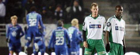 Molde jubler for scoring mens Knut Henry Haraldsen og Olivier Karekezi henger med hodet.
