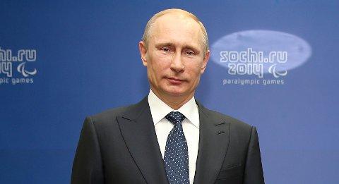 President Vladimir Putin ser ut til å være godt fornøyd med at Jens Stoltenberg overtar som NATOs generalsekretær.