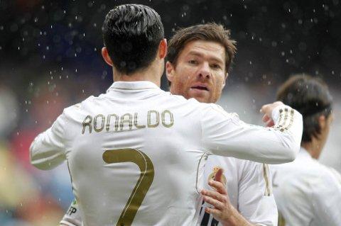 Cristiano Ronaldo og Xabi Alonso kan kalle seg seriemestere i Spania.