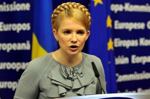 Julia Timosjenko sier hun ble slått i forbindelse med at hun skulle overføres fra fengsel til et sykehus for snart to uker siden.